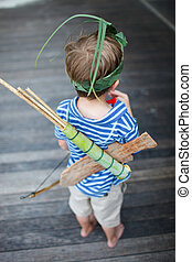 Boy outdoors - Back view of 5 years old bow with wooden...