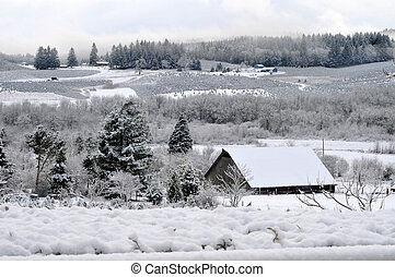 Snowscape with a barn or farm or house in the lower right...