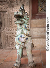 Dog-lion statue decorated with stones