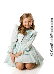 Little girl making face sitting isolated on white