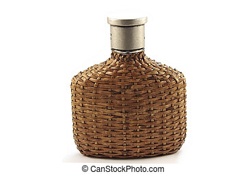 Bottle of perfume covered with rattan isolated in white...