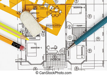 House plan blueprints close up with pencil and template