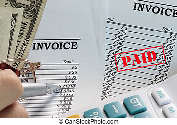 Paid invoice in a spreadsheet with dollars and pen