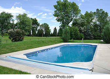 Backyard In-Ground Swimming Pool on a Sunny Summer Day