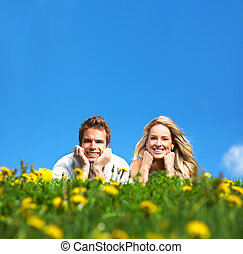 Love couple - Young love couple smiling under blue sky