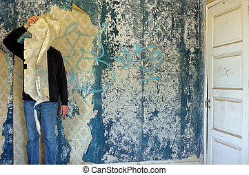 collective memory - Male figure behind torn wallpaper shred...