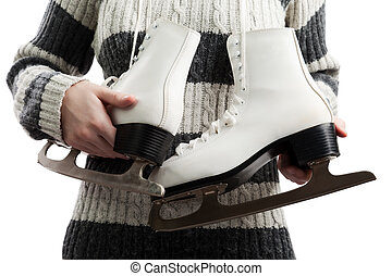 Women holding ice skates - Women holding winter activity...