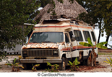 placencia, old rusty van, mobile home, camper on a beach with palm trees, trailer van