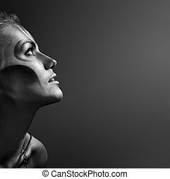 close-up portrait of beautiful woman with silver bodyart -...