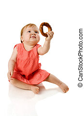 Baby eating - One year Baby eating tasty cookie isolated on...