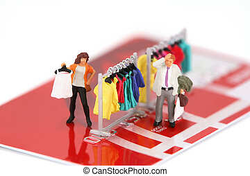 Miniature shoppers on a credit card - Concept image of...
