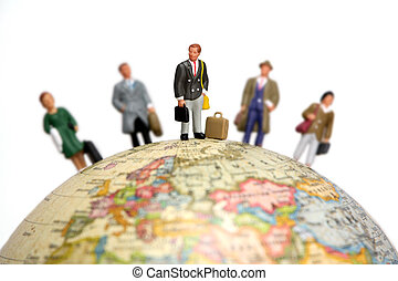 Business travel concept - A group of miniature bussnessmen...