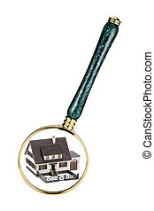 Home inspection concept - A magnifying glass examining a...