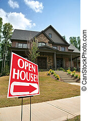 Open house sign in front of a new home