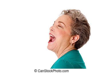 Happy senior woman talking screaming yelling singing with...