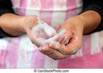Foamy hands - foamy wet female hands clouseup