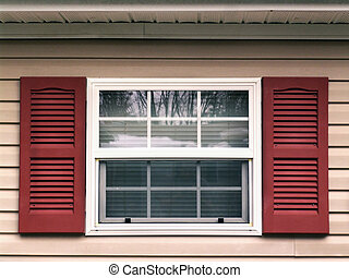Window shutters - Close up shot of a window with red wood...