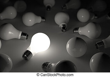 Lit light bulb - One lit light bulb amongst other broken...
