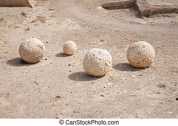 ancient catapult balls - public access castle of Almeria...