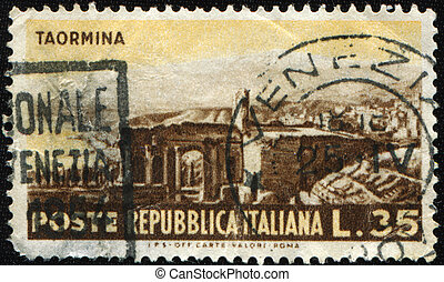 RUINS OF THE TAORMINA THEATRE - ITALY - CIRCA 1953: A stamp...