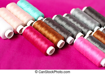 Spools of sewing threads - Set of different colored sewing...