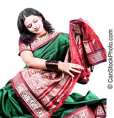 Checking New Saree - A beautiful Indian woman checking the...