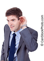 business man cupping hand behind ear - Young business man...
