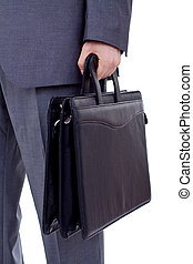 business person holding a suitcase - Low section image of a...