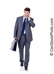 Business man Walking forward while talking on the phone over...