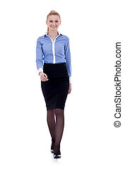 Smiling business woman walking. Isolated in white.