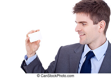 man looking at his  business card