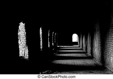 Old dark passage - An old dark passage with the light coming...