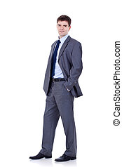business man standing with hands in pockets