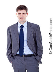 man standing with his hands in pockets