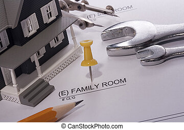 Family Room Construction - House model and drafting tools on...
