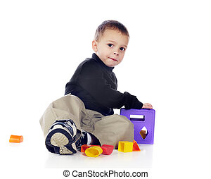 3-D Puzzler - An adorable preschooler playing with a...