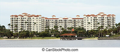 multi story waterfront luxury condos - stitched panoramic of...