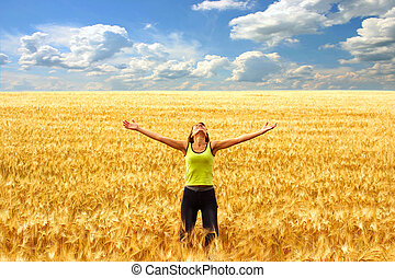 Freedom and happiness - Happy young woman in the yellow...