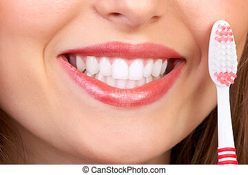 woman with tooth-brush - Smiling young woman with healthy...