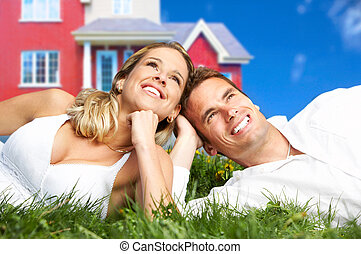 Love couple - Young love couple smiling dreaming about a new...