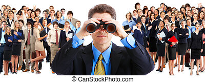 human resources - businessman with binoculars looking at the...