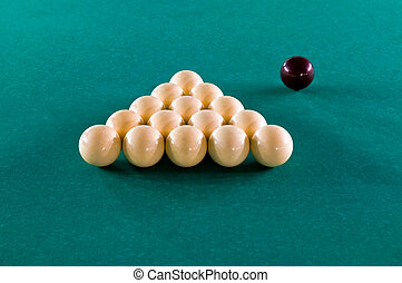 Billiard balls on a green baize table
