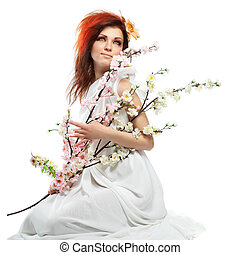 Portrait of beautiful woman with spring flowers on white
