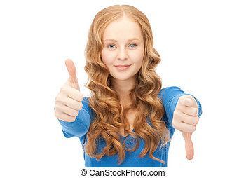 thumbs up and thumbs down - bright picture of lovely teenage...