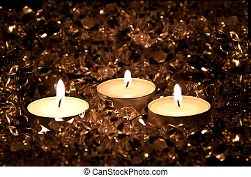 Lighted candles on a golden background