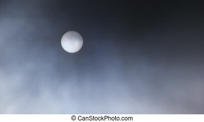 Full moon and flying clouds