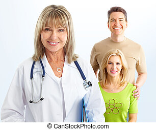 doctor and young couple - Smiling medical doctor with...