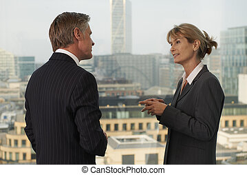 Business people - Senior business man and woman standing by...
