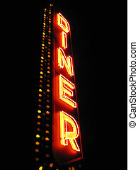 """Diner Neon - A large neon sign says """"DINER"""" against a black..."""