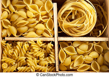 Set of four varieties of pasta in a wooden box